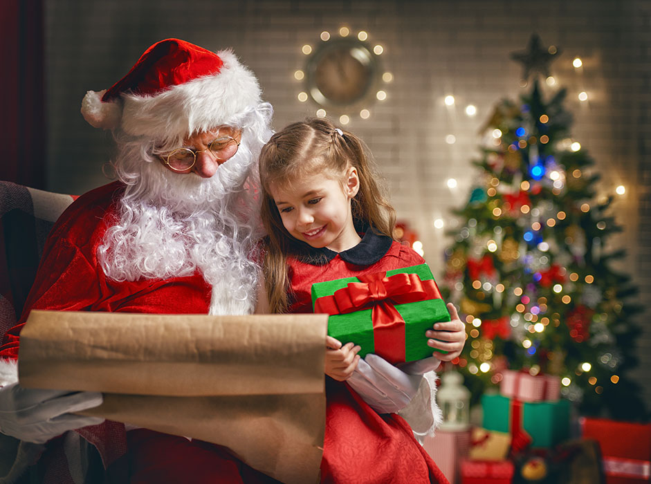 Santa Claus giving a present to a little cute girl